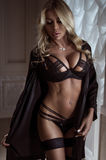 Sexy blonde woman with long hair in black lingerie Royalty Free Stock Photo