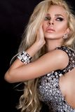 blonde woman with long hair dressed in elegant crystals dress stock photo