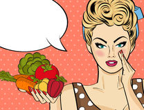Sexy blonde woman with many vegetables in his hands Stock Photos