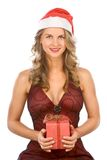 Sexy blonde woman Mrs. Claus with Christmas gift Royalty Free Stock Photography