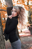 Sexy blonde woman in nature at autumn Stock Image