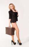 Sexy blonde woman on old suitcase Royalty Free Stock Photos