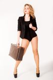 Sexy blonde woman on old suitcase Royalty Free Stock Images