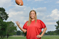 Sexy blonde woman playing American football Royalty Free Stock Photo