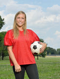 Sexy blonde woman playing soccer Stock Photography
