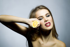 Sexy blonde woman portrait with orange Royalty Free Stock Photos
