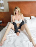 Sexy blonde woman poses in lingerie Stock Image