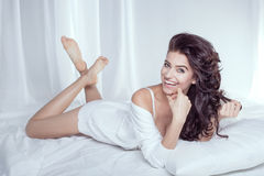 Sexy blonde woman posing in bed Royalty Free Stock Photography