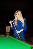 Sexy blonde woman rubbed cue chalk Royalty Free Stock Images
