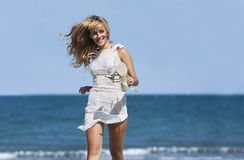 Sexy blonde woman running windblown Stock Images
