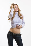 Sexy blonde woman show her belly Royalty Free Stock Image