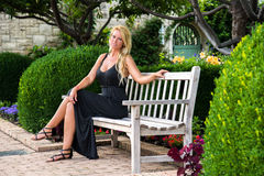 Sexy Blonde Woman Sitting on Bench Fashion Royalty Free Stock Photo