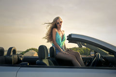 Sexy blonde woman sitting in a car Royalty Free Stock Images