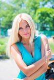 blonde woman smiling among the green leaves Stock Photography