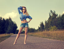 Sexy Blonde Woman Standing on the Road Royalty Free Stock Photo