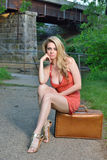 Sexy blonde woman with suitcase Stock Image