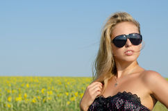 Sexy blonde woman in sunglasses Stock Photography