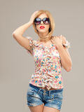 Sexy blonde woman with sunglasses posing Royalty Free Stock Photos