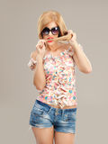 blonde woman with sunglasses posing Stock Photo
