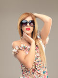 Sexy blonde woman with sunglasses posing Royalty Free Stock Photo
