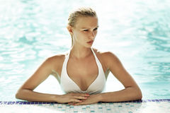 blonde woman in the swimming pool Stock Photo