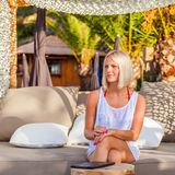 Sexy blonde woman with tablet relaxing on the beach. Royalty Free Stock Photos