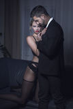 Sexy blonde woman in underwear cuddle to stylish man Royalty Free Stock Images
