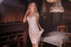 Sexy blonde woman in vintage room. Stock Image