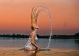 Sexy blonde woman in water at sunset Royalty Free Stock Photos