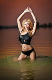 Sexy blonde woman in water at sunset Stock Photo