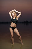 Sexy blonde woman in water after sunset Royalty Free Stock Image