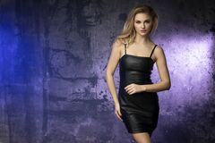 Free Sexy Blonde Woman Wear Black Leather Dress In Grunge Room Stock Photo - 184909950