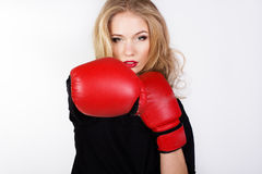 Sexy blonde woman is wearing box gloves Stock Photos