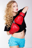 Sexy blonde woman is wearing box gloves Stock Photography