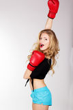 Sexy blonde woman is wearing box gloves Royalty Free Stock Images