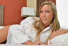 Sexy blonde woman wearing only men's shirt - bedroom Stock Photos