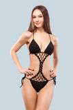 Sexy blonde woman wearing swimwear posing on color background. Perfect body. Bikini catalogue. Stock Images