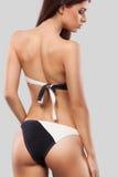 Sexy blonde woman wearing swimwear posing on color background. Perfect body. Bikini catalogue. Royalty Free Stock Image