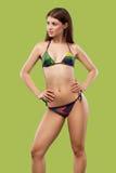 Sexy blonde woman wearing swimwear posing on color background. Perfect body. Bikini catalogue. Stock Photography