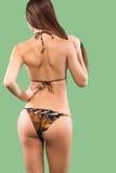 Sexy blonde woman wearing swimwear posing on color background. Perfect body. Bikini catalogue. Royalty Free Stock Images