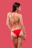 Sexy blonde woman wearing swimwear posing on color background. Perfect body. Bikini catalogue. Stock Photo