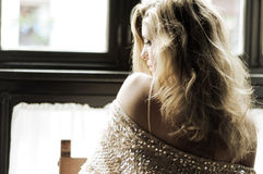 Sexy blonde woman in window Royalty Free Stock Photos