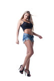 Sexy blonde young woman in denim shorts Royalty Free Stock Images