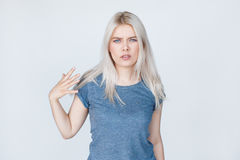 Sexy blonde young woman showing rude gesture Royalty Free Stock Photo