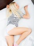 Sexy blondie sleeping in short pants Stock Image