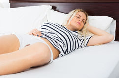 Sexy blondie sleeping in short pants Royalty Free Stock Photo