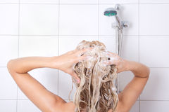 Sexy blondie woman washing her hair Royalty Free Stock Images