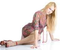 sexy blondy on high red heels sitting on floor Royalty Free Stock Photo