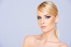 Sexy blue-eyed woman wearing makeup Stock Photo