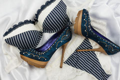 Sexy blue lingerie and denim shoes with rhinestones Stock Images